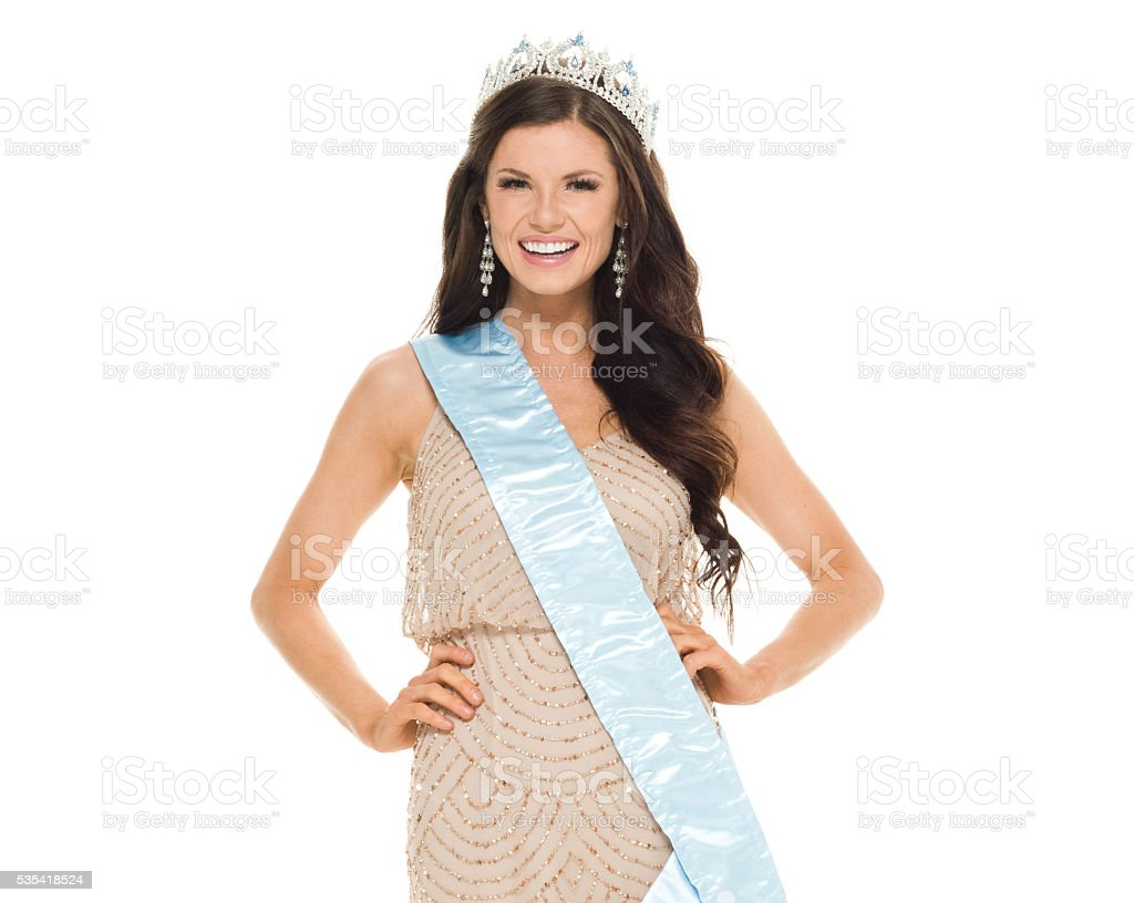 Cheerful female beauty queen looking at camera stock photo