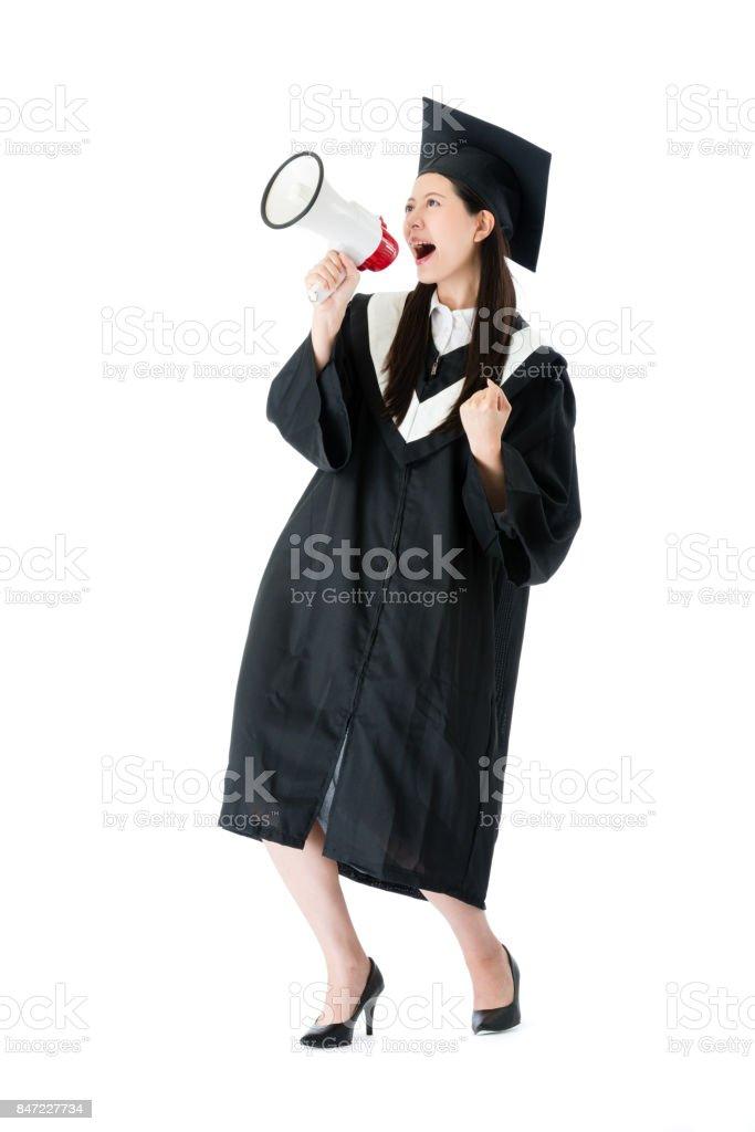 cheerful female college student using megaphone stock photo