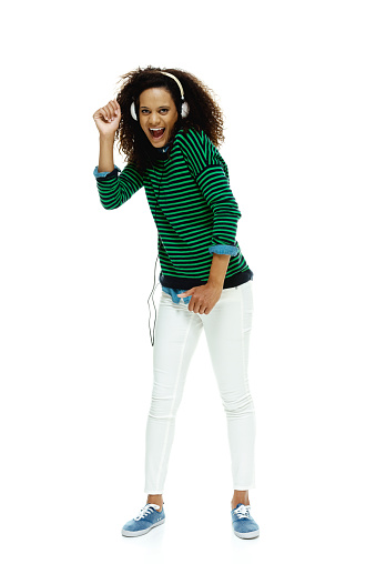 Cheerful female listening music and dancinghttp://www.twodozendesign.info/i/1.png