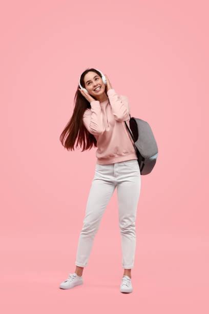 Cheerful female listening to music stock photo