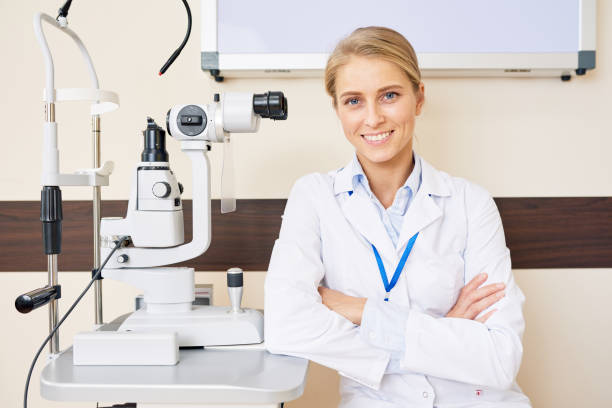 cheerful female ophthalmologist - optometrist stock pictures, royalty-free photos & images