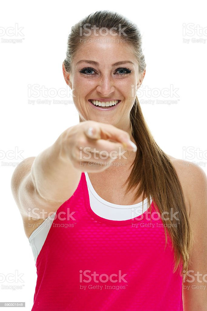 Cheerful female pointing at camera royaltyfri bildbanksbilder