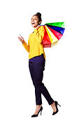 istock Cheerful female shopper with mobile phone 539651572