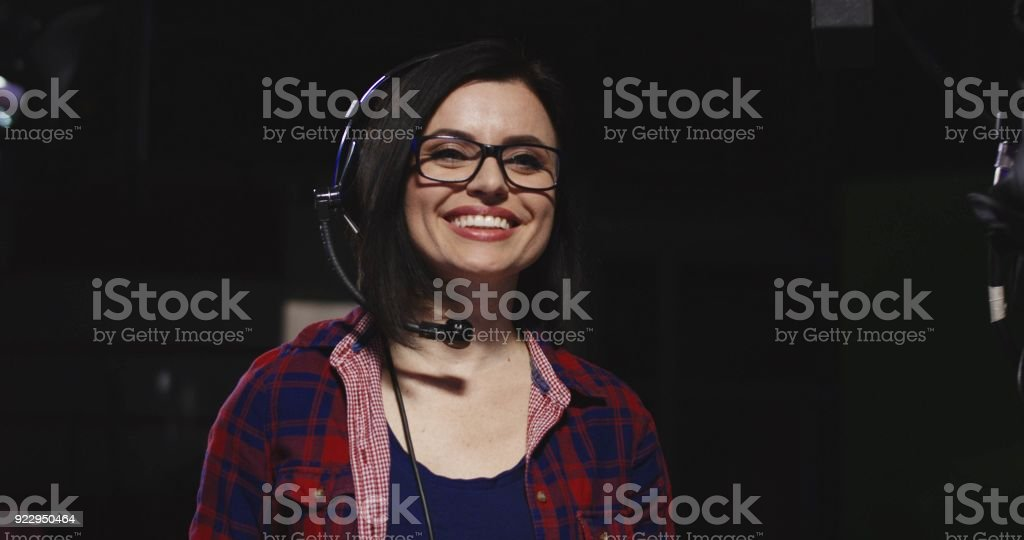 Cheerful female stage manager in work stock photo