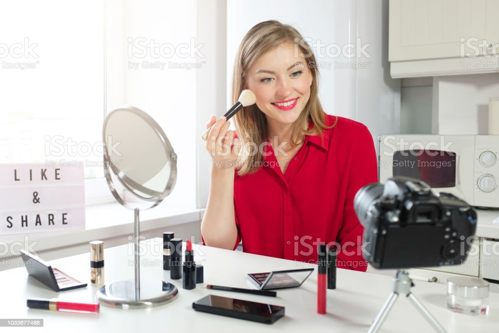 Cheerful Female Vlogger Showing Her Brush For Make Up Recording