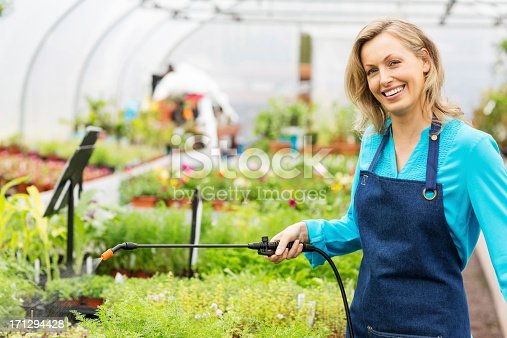 927641110 istock photo Cheerful Female Worker Spraying Insecticide 171294428