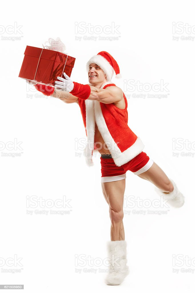 Cheerful fitness Santa Claus holding a red box foto stock royalty-free