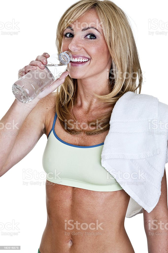 Cheerful fitness woman drinking water royalty-free stock photo