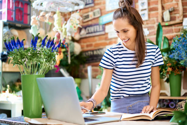 Cheerful florist looking at laptop and writing down client orders in picture id1040964750?b=1&k=6&m=1040964750&s=612x612&w=0&h=wksb6dol 8o8wi12zvd1imyqojml3lh1dij7tfrpnde=