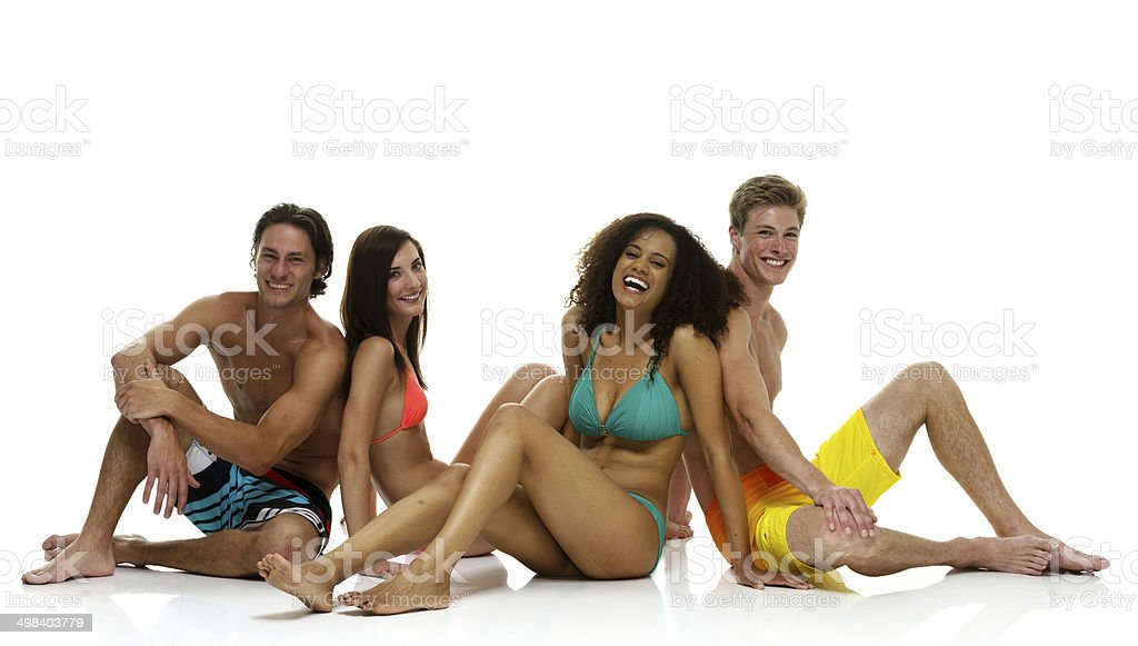Cheerful four friends sitting on floor royalty-free stock photo