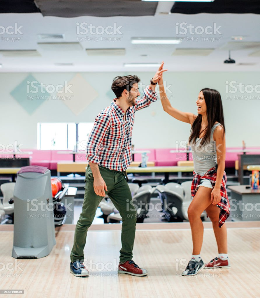 Cheerful Friends Bowling Together stock photo