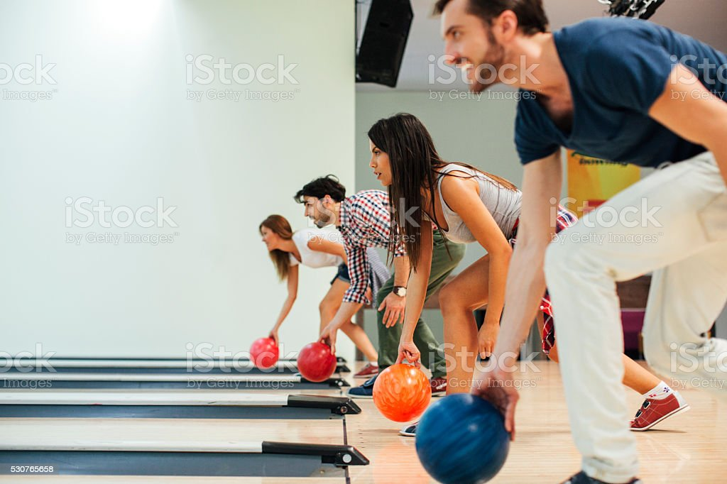 Cheerful Friends Bowling Together. stok fotoğrafı