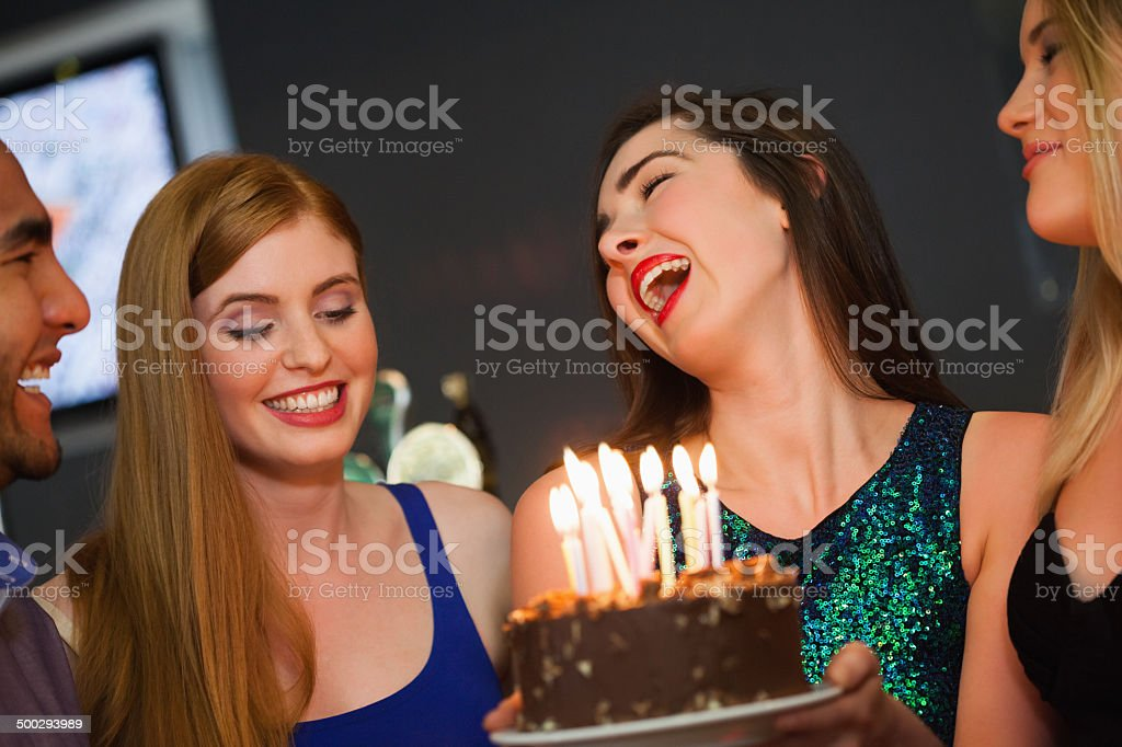 Cheerful friends celebrating birthday together stock photo
