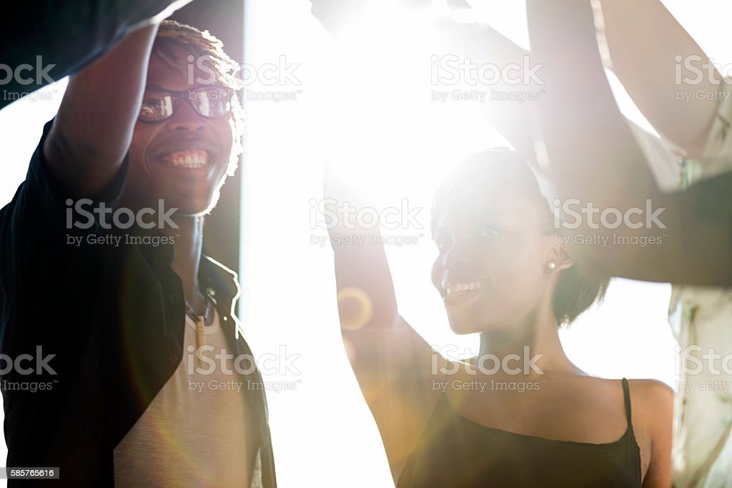Cheerful Friends Dancing At An Outdoor Party stock photo