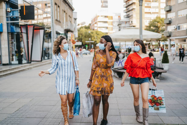 Cheerful friends enjoy shopping stock photo