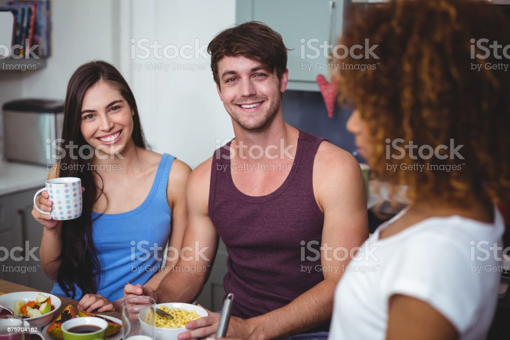 Cheerful friends having breakfast royalty-free stock photo
