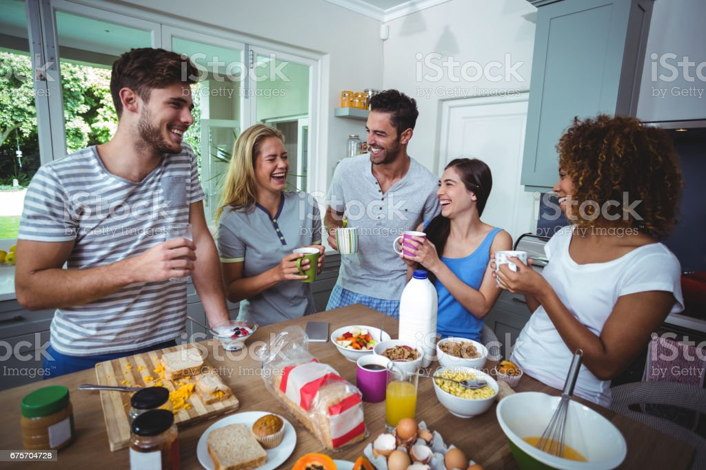 Cheerful friends holding drinks royalty-free stock photo