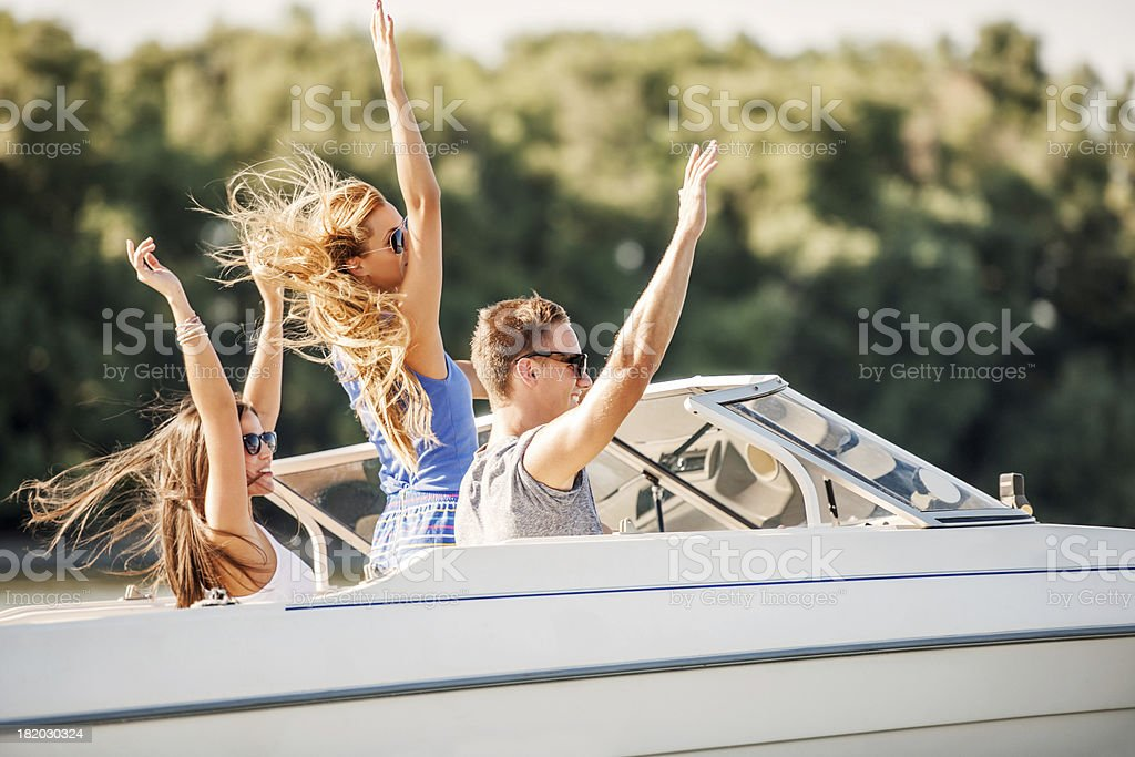 Cheerful friends on a speedboat. royalty-free stock photo