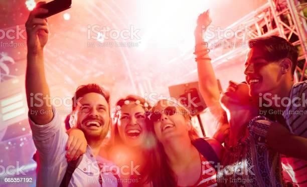 Cheerful friends partying in club at night picture id665357192?b=1&k=6&m=665357192&s=612x612&h=friy9z zao8fjfvycwprmroksw0v68bm8kju2gyzepg=