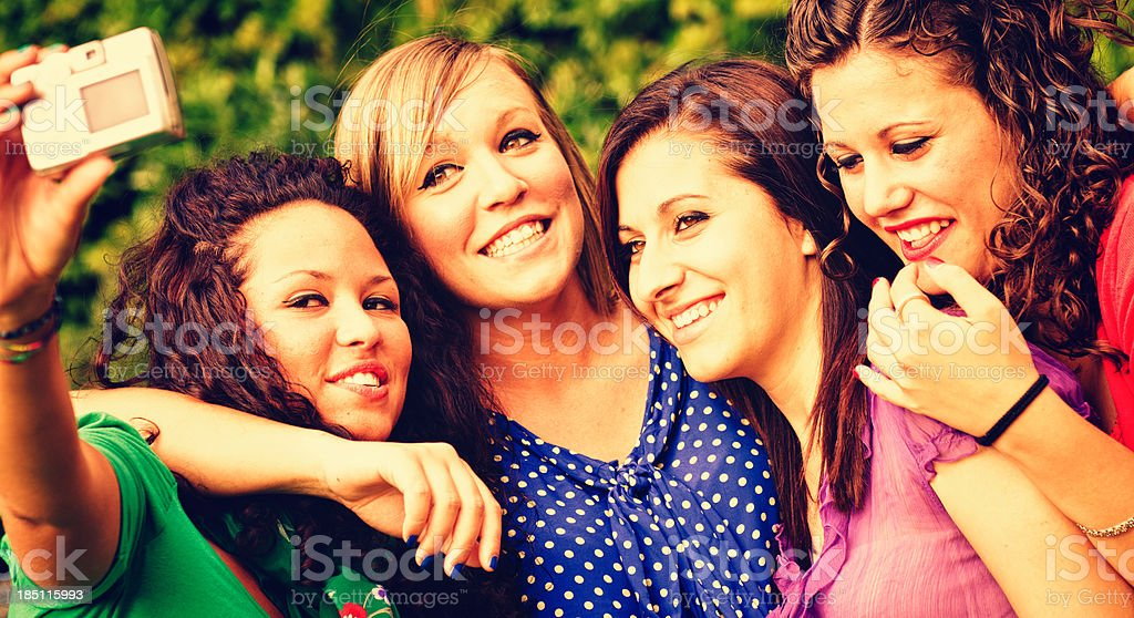 Cheerful friends snap picture and enjoy in the park royalty-free stock photo