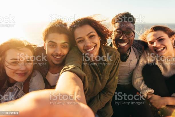 Cheerful friends taking selfie on a holiday picture id913083924?b=1&k=6&m=913083924&s=612x612&h=6eq8hmuohserbeah44loxirjozwhivnsj atsmpm9ea=