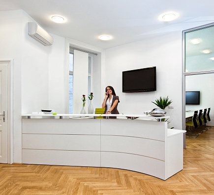 istock Cheerful front desk lady doing her job with passion 473593362