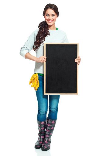 Cheerful Gardener With Blackboard Stock Photo - Download Image Now