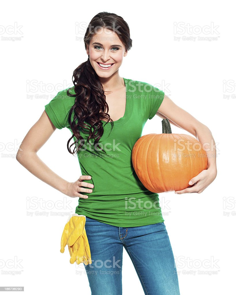 Cheerful gardener with pumpkin Portrait of beautiful gardener holding a perfect pumpkin and smiling at the camera. 20-24 Years Stock Photo
