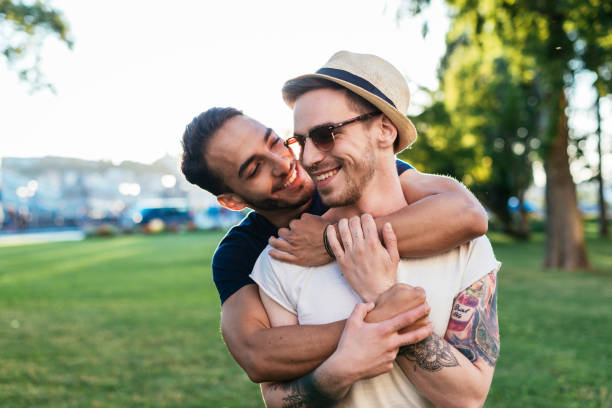 Cheerful gay couple expressing love to each other while on vacation stock photo