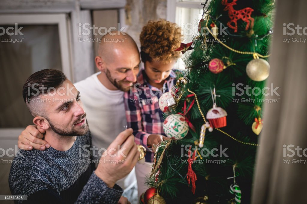 Young gay family with a adopted little girl, enjoying their time at...
