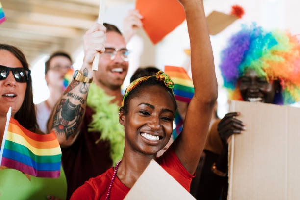 Cheerful gay pride and lgbt festival Cheerful gay pride and lgbt festival gay pride parade stock pictures, royalty-free photos & images