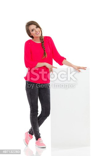 istock Cheerful girl and a blank placard 497132283