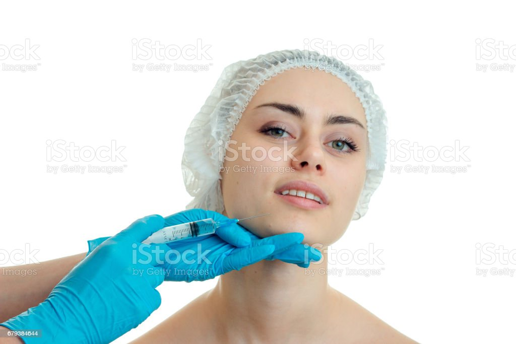 cheerful girl at the plastic surgeon isolated on white background royalty-free stock photo