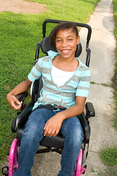 Cheerful girl in wheelchair stock photo