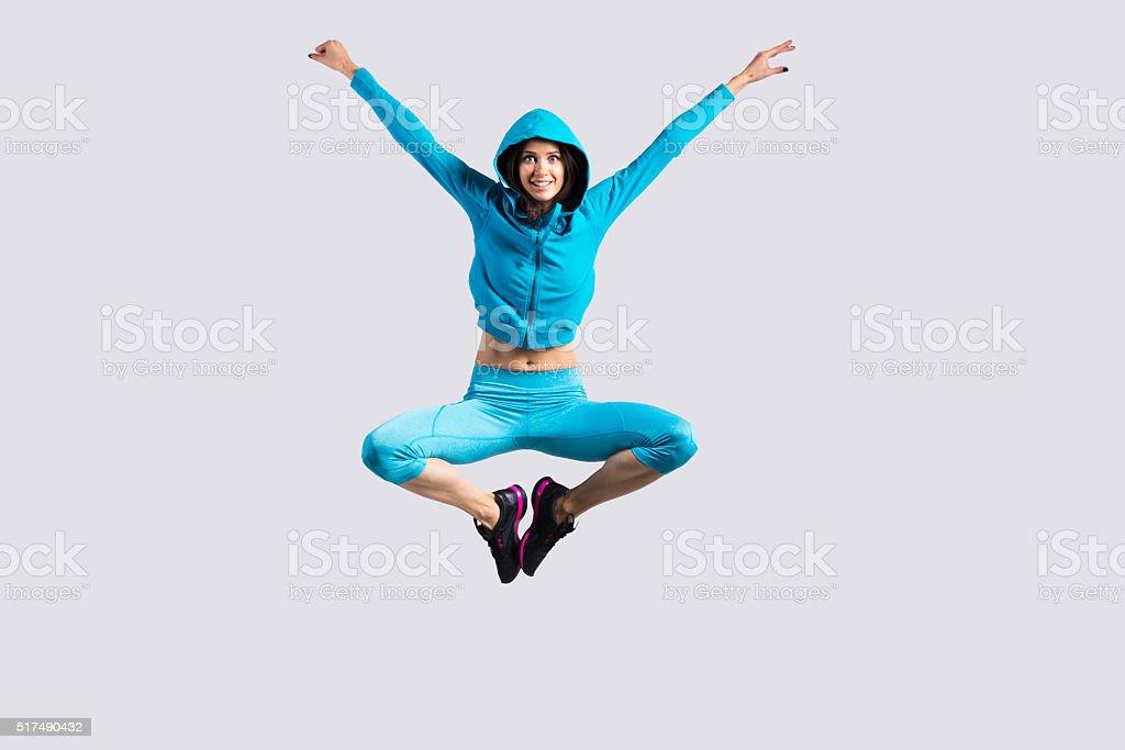 Cheerful girl jumping stock photo
