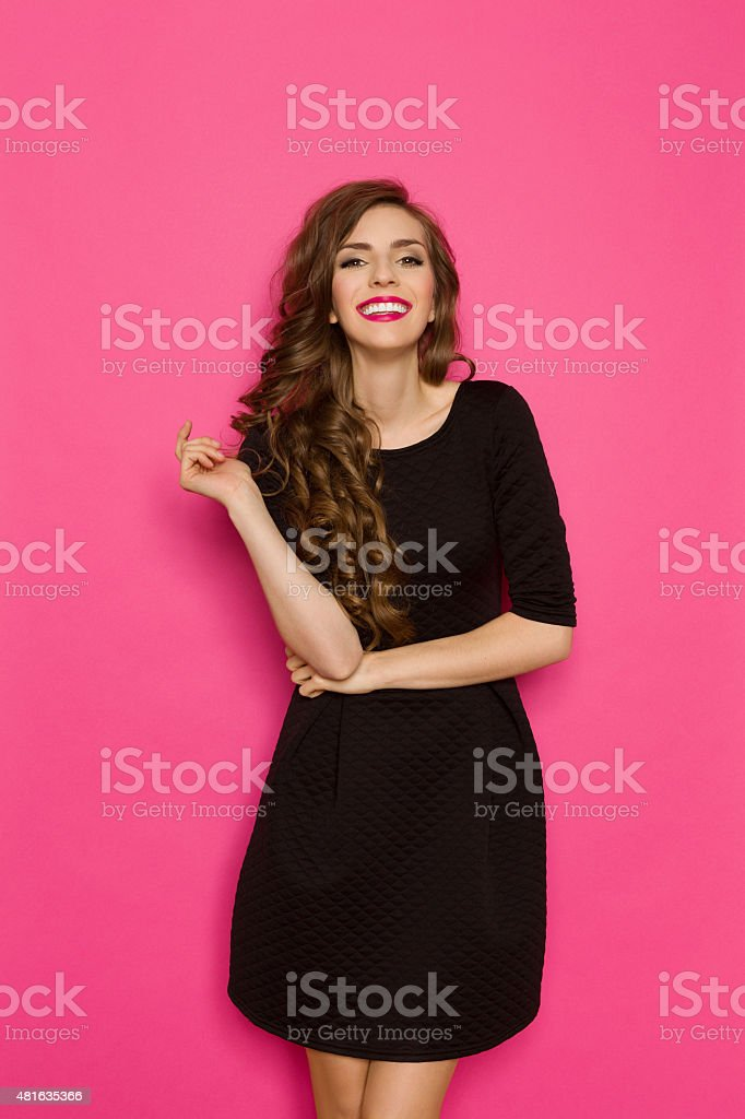 Cheerful Girl On A Pink Background stock photo