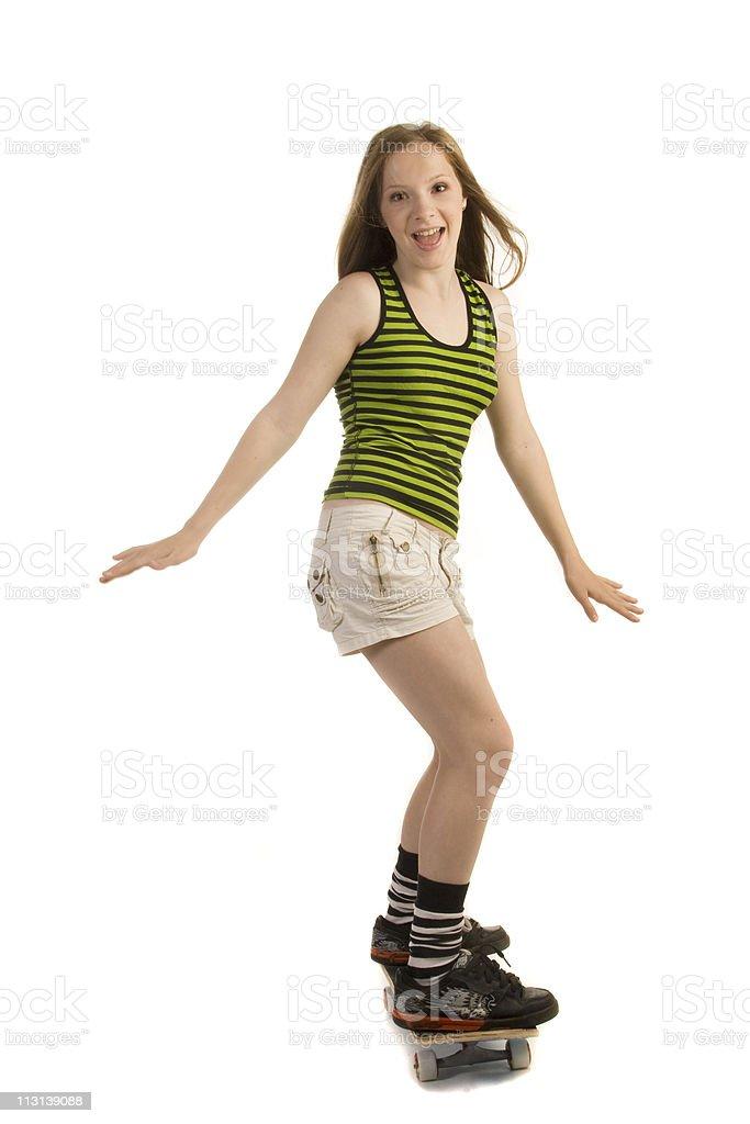 Cheerful girl on the skateboard. stock photo