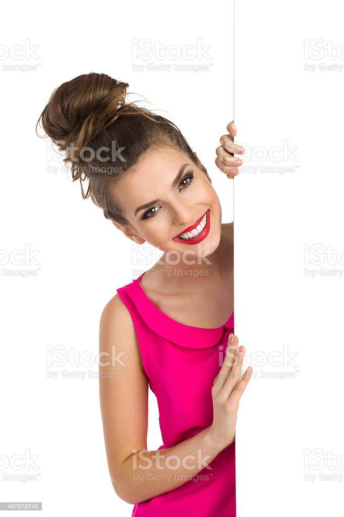 Cheerful Girl Peeking stock photo
