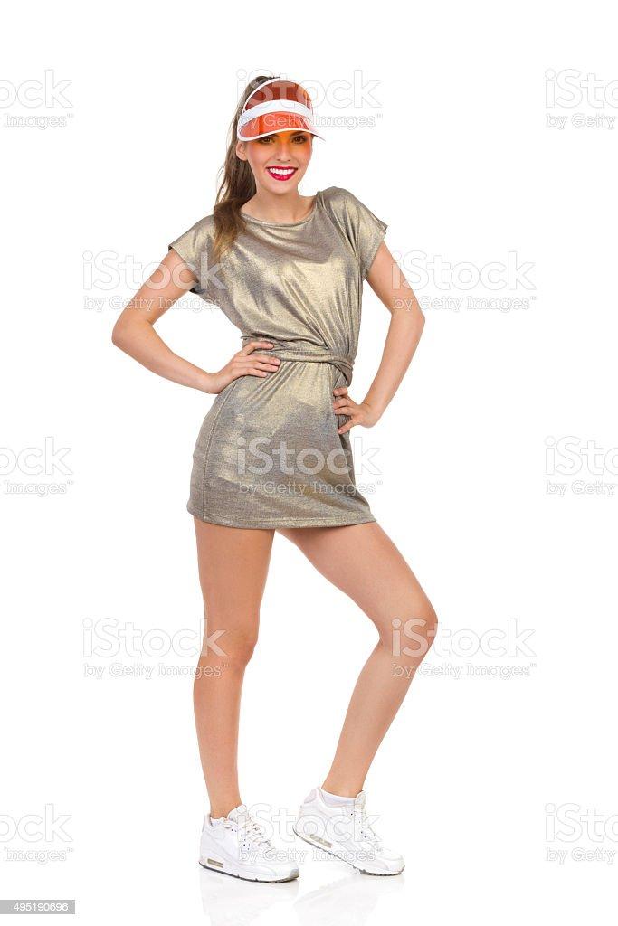 Cheerful Girl Posing In Orange Sun Visor stock photo