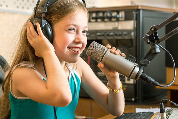 cheerful girl radio dj - radio dj stock photos and pictures