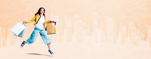Cheerful girl shopping and walking in the city stock photo