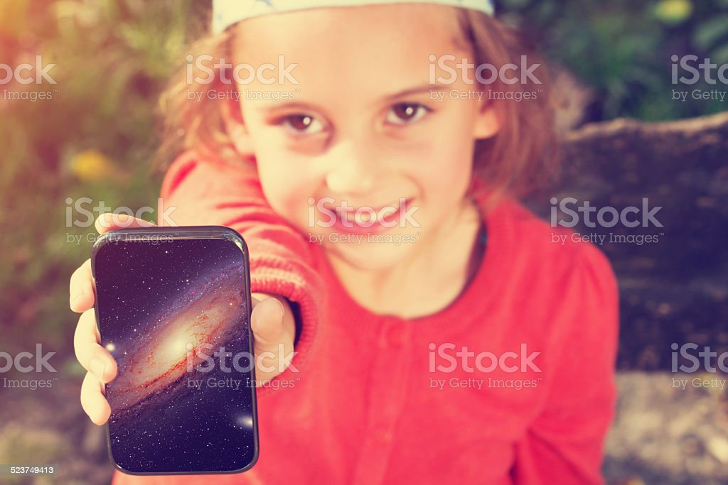 Cheerful girl showing space photo stock photo