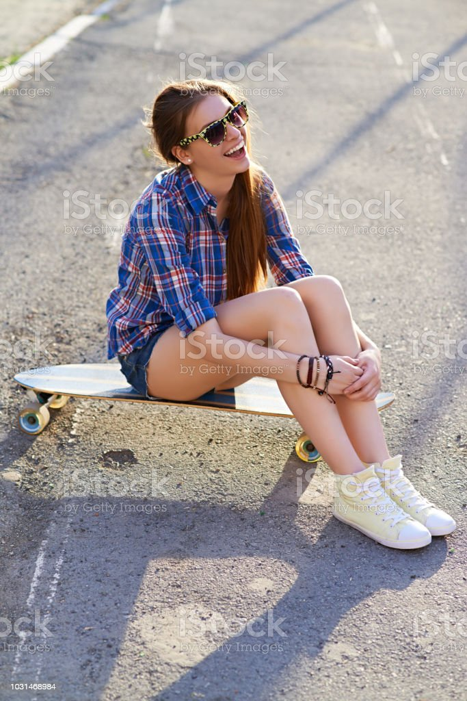 Young attractive Caucasian girl in sunglasses and casual clothes...