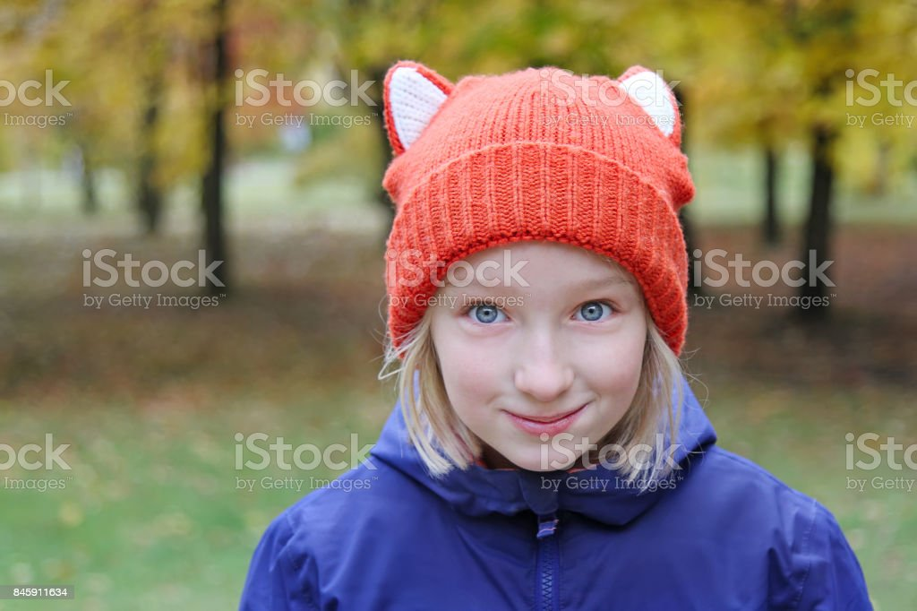 03cff8def Cheerful Girl Smiling The Child Is Dressed In A Funny Knitted Warm ...