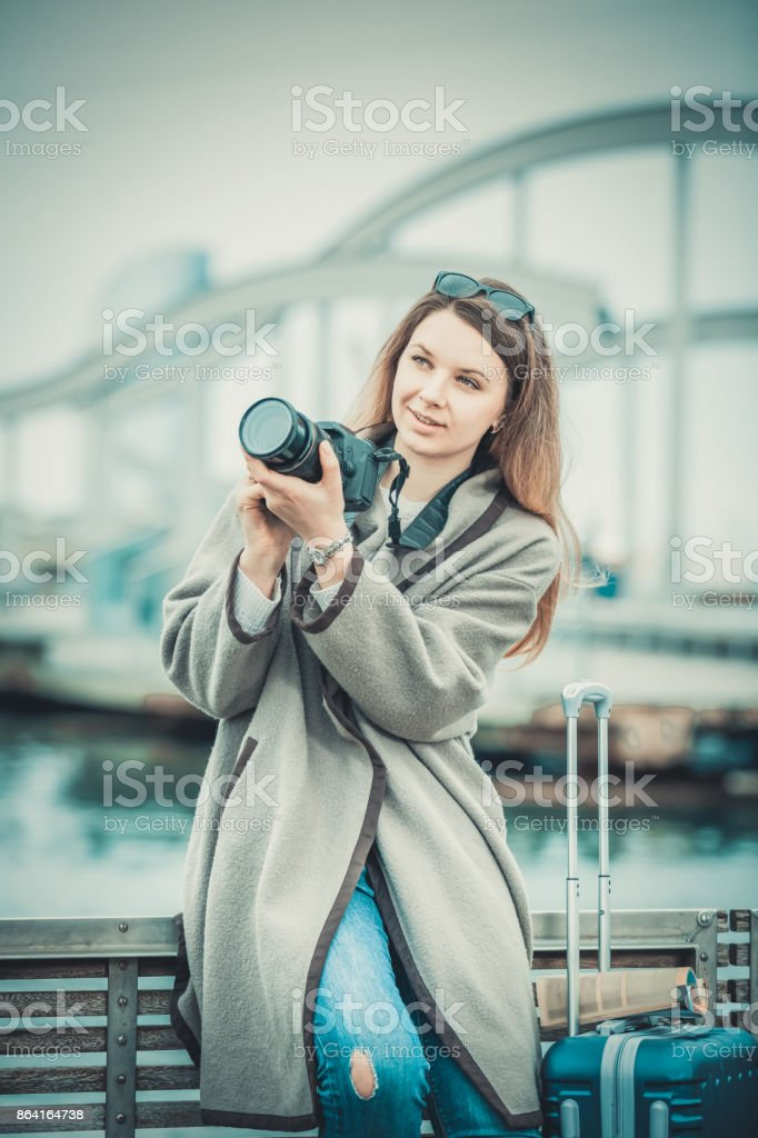 Cheerful girl taking picture with her camera royalty-free stock photo
