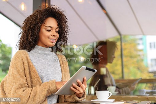istock cheerful girl using tablet outdoors 629010722