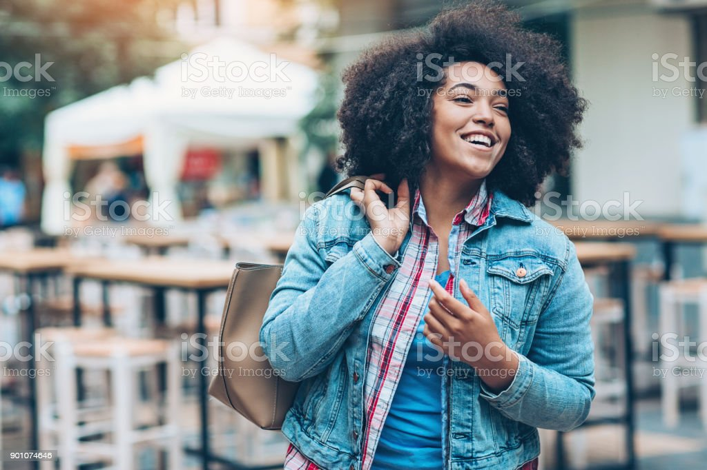 Cheerful girl walking outdoors stock photo