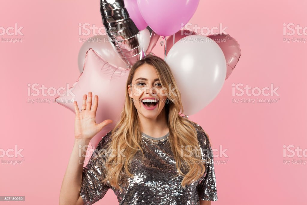 Cheerful girl with balloons stock photo