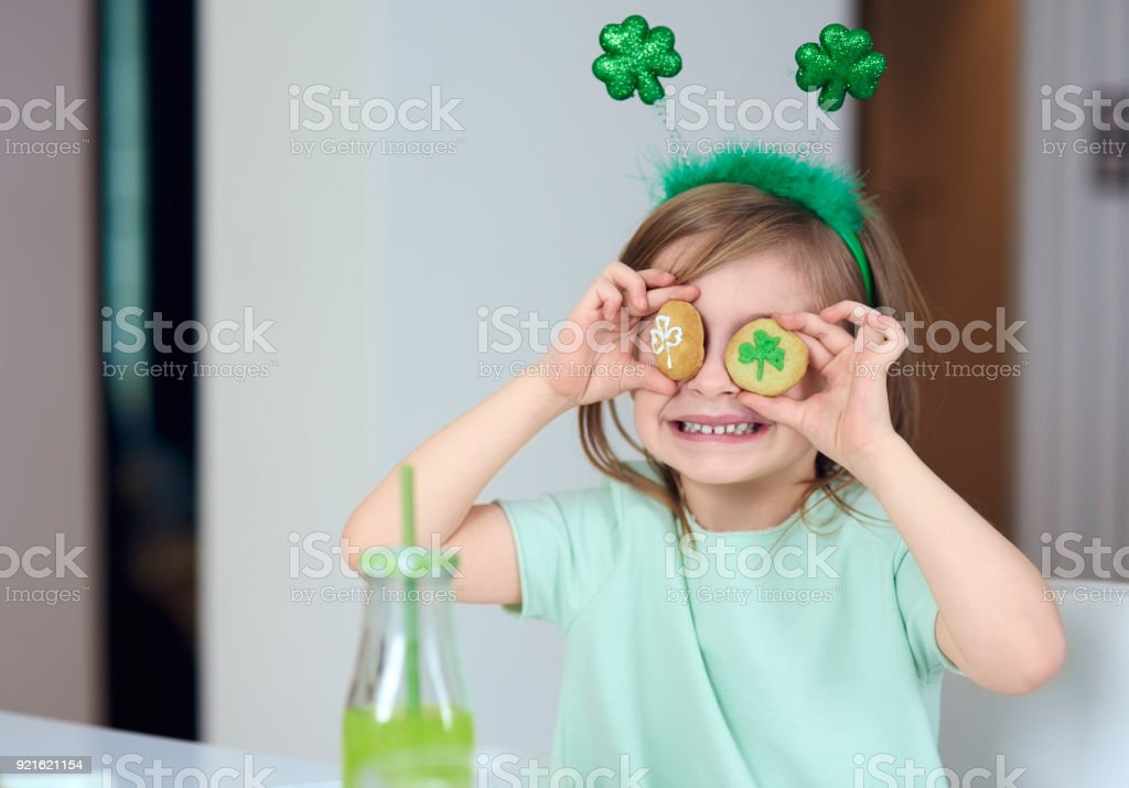 Cheerful girl with cookie having a fun stock photo