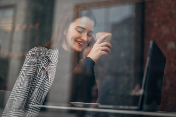 Cheerful girl with red lipstick on a coffee break stock photo